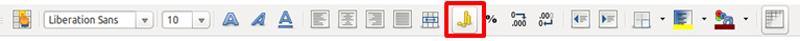 Botón para aplicar el formato moneda en la barra de Formato